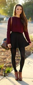 Want to dress up? Pair a maroon sweater with a high waisted skirt and stockings. Then, add contrasting accessories like light brown shoes and a purse, as shown above.